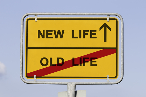 A sign displaying a new life and old life to implement a name change.